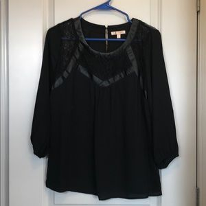 Black top with lace and faux leather detail